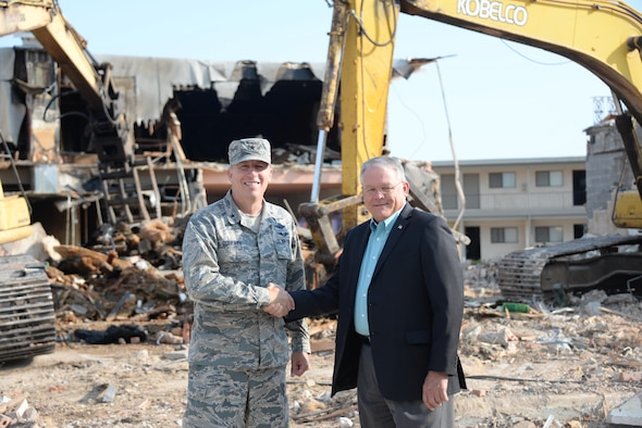 82nd Training Wing Commander Brig. Gen. Patrick Doherty shakes hands with Wichita Falls Mayor Glenn Barham outside Sheppard's Main Gate. Demolition is ongoing as part of a $3.5 million project by the city to improve the area.