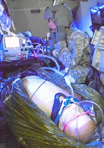 Sgt. Marty Anderson, Det. 1, Company C, 3rd Battalion, 238th Aviation Regiment, Michigan National Guard, monitors the status of a medical patient simulator while onboard a UH-60 Blackhawk trainer. Taught at the U.S. Army Medical Department Center and School at Fort Sam Houston, the flight paramedic course trains 68Ws medical enlisted personnel with the knowledge and skills required to conduct advanced critical care pre-medical evacuation treatment, loading and unloading patients in MEDEVAC aircraft, and stabilize and treat patients in flight.
