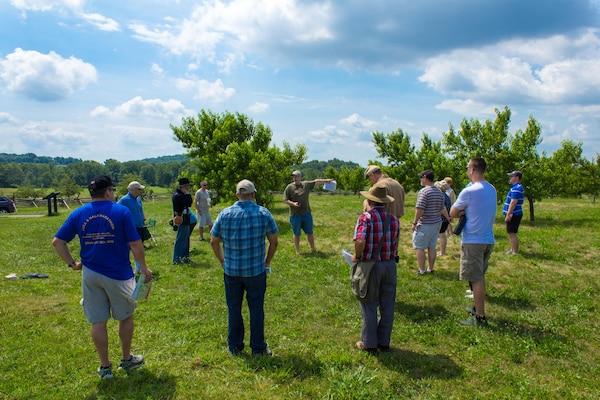 DIA Analyst Greg Elder details troop movements at the Peach Orchard on Gettysburg National Battlefield.