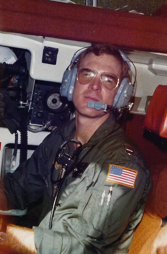 Capt. Robert Allen, 62nd Airlift Wing historian, navigates on board a C-130 aircraft during a flight in 1980 in Little Rock, Arkansas. Allen served 20 years in the Air Force and flew as a navigator aboard C-130Es, AC-130 Spectre and C-141A Aircraft. (Courtesy photo)