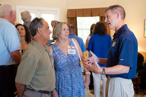 Brig. Gen. Wayne Monteith, 45th Space Wing commander, and City of West Melbourne Mayor Hal Rose, and his wife, Sue, discuss the SpaceX launch during a community relations event at the 45th Space Wing commander's residence Aug. 13, 2016, at Patrick Air Force Base, Fla. The 45th Space Wing supported the SpaceX launch and landing, which launched from Cape Canaveral Air Force Station, Fla. at 1:26 a.m. ET Aug. 14, 2016. (U.S. Air Force photo/Matthew Jurgens)