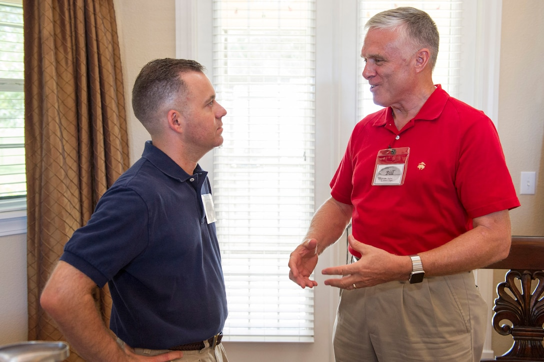"""Col. Walt Jackim, 45th Space Wing vice commander, and retired U.S. Air Force Lt. Gen. William """"Bill"""" Welser III, who leads the local Space Coast Honor Flight mission, discuss upcoming Honor Flight plans during a community relations event at the 45th Space Wing commander's residence Aug. 13, 2016, at Patrick Air Force Base, Fla. The next Honor Flight is scheduled to depart at 3 a.m. Aug. 20, 2016, from Melbourne, Fla. (U.S. Air Force photo/Matthew Jurgens)"""
