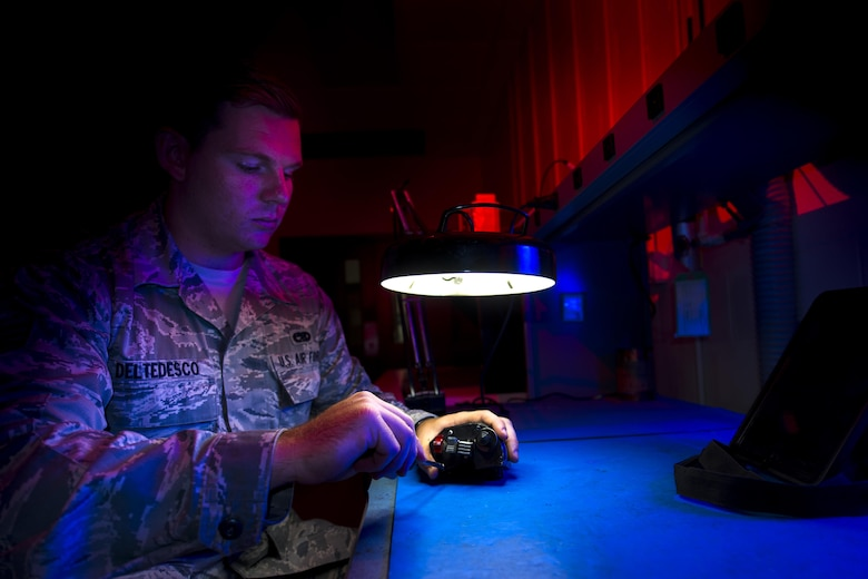 Senior Airman Jacob Del Tedesco, a 23rd Component Maintenance Squadron electrical and environmental systems craftsman, unscrews a right-handed grip from an A-10C Thunderbolt II at Moody Air Force Base, Ga., Aug. 11, 2016. Del Tedesco found a more timely and cost-effective way of repairing the grips, which led to an Air Force-wide change to the maintenance guidelines used for repairing them. (U.S. Air Force photo/Airman 1st Class Daniel Snider)
