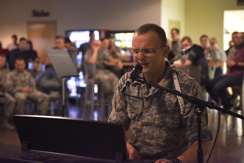 U.S. Air Force Airman Wyatt Hall, 316th Training Squadron student, sings while playing the piano at Crossroads Student Center on Goodfellow Air Force Base, Texas, Aug. 13, 2016. The performance was part of Goodfellow's Got Talent, an event showcasing students' different talents. (U.S. Air Force photo by Airman 1st Class Chase Sousa/Released)
