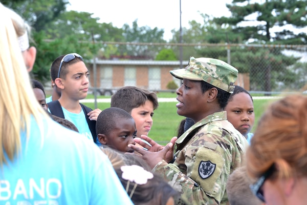 DLA Troop Support C&T Senior Logistician Army Master Sgt. Cynthia Gyening greets campers during the Philly Play Summer Challenge August 10, 2016. DLA Troop Support noncommissioned officers and other local military personnel helped children complete seven obstacle courses during the event.