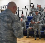 Senior Airman Alex Searless, 460th Operations Group intelligence analyst, asks a question of Col. David Miller Jr., 460th Space Wing commander, during Miller's first commander's call at the Buckley Fitness Center Aug. 15, 2016, on Buckley Air Force Base, Colo. During his speech, Miller spoke to members of Team Buckley about his personal life, career experiences, expectations and vision for the base. (U.S. Air Force photo by Airman Holden S. Faul/ Released)