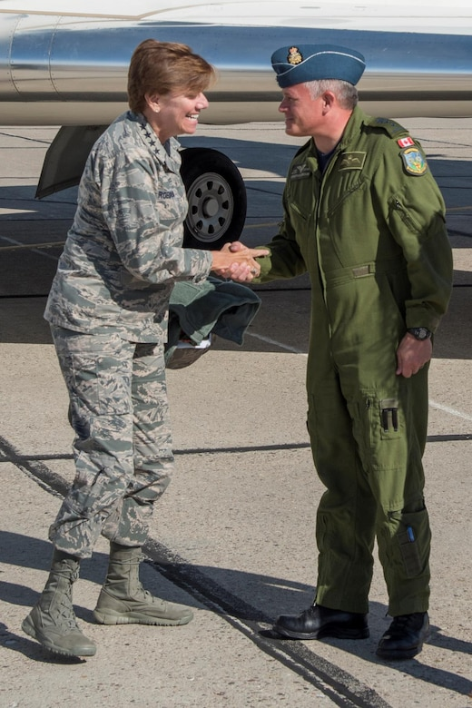 Major-General Christian Drouin (right), Commander of 1 Canadian Air Division, welcomes General Lori Robinson (left), Commander of the North American Aerospace Defense Command and U.S. Northern Command, to 4 Wing Cold Lake, Alberta, Canada, August 15, 2016.