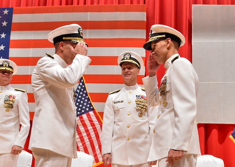 FLEET ACTIVITIES YOKOSUKA, Japan (Aug. 17, 2016) Rear Adm. William R. Merz and Rear Adm. Richard Correll exchange salutes during their change of command ceremony. Correll relieved Merz as the 45th commander of Submarine Group 7. (U.S. Navy photo by Mass Communication Specialist 2nd Class Brian G. Reynolds)