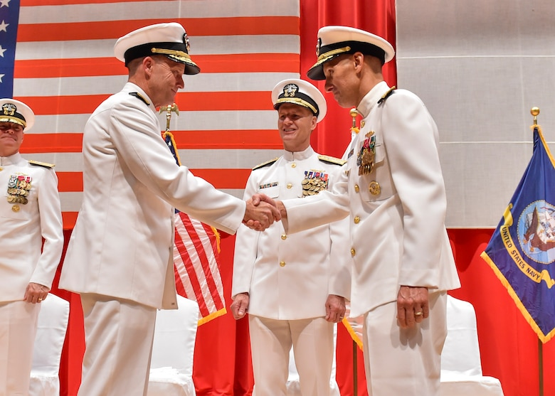 FLEET ACTIVITIES YOKOSUKA, Japan (Aug. 17, 2016) Rear Adm. William R. Merz shakes hands with Rear Adm. Richard A. Correll during a change their command ceremony. Correll relieved Merz as the 45th commander of Submarine Group 7. (U.S. Navy photo by Mass Communication Specialist 2nd Class Brian G. Reynolds)