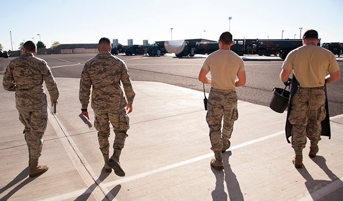 (From left to right) 92nd Logistics Readiness Squadron refueling equipment operators: Senior Airman Devin Carpenter, Airman 1st Class Robert Santana, Airman 1st Class Alexander Munson and Airman Victor Ortiz walk out to the fuel equipment staging area July 25, 2016, at Fairchild Air Force Base, Wash. At the start of every shift, fuels equipment operators go through an extensive checklist to ensure operational safety. (U.S. Air Force photo/ Airman 1st Class Ryan Lackey)