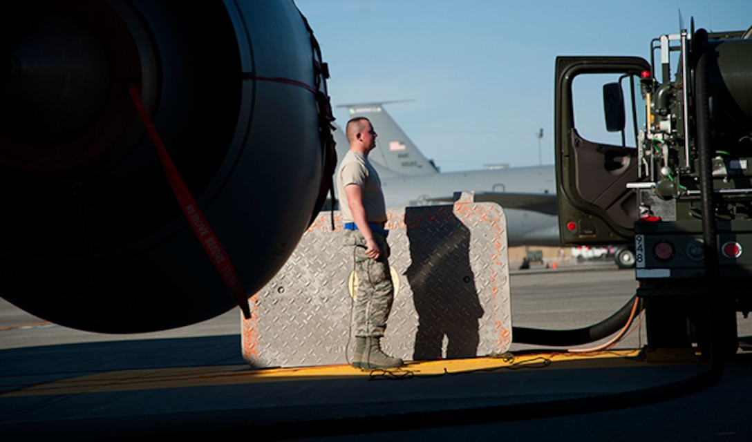 Airman 1st Class David Renzo, 92nd Logistics Readiness Squadron refueling equipment operator, monitors the fuel pressure gauges on his assigned hydrant truck as it fuels up a KC-135 Aug. 16, 2016, at Fairchild Air Force Base, Wash. Refueling actions on a dry KC-135 may take approximately an hour or longer depending on the demand for fuel at a given time. (U.S. Air Force photo/ Airman 1st Class Ryan Lackey)
