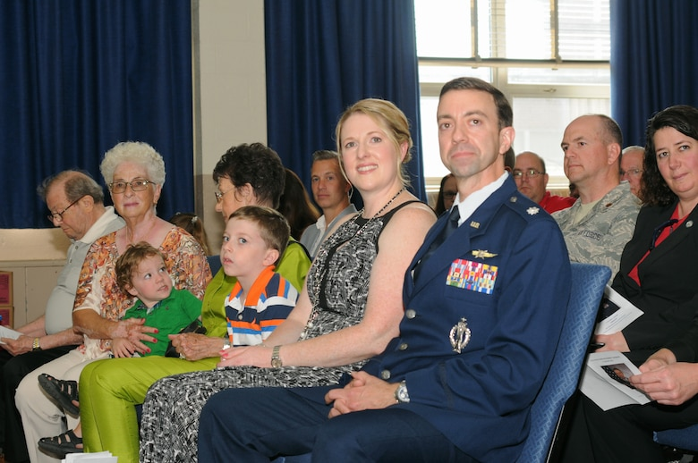 Lt. Col. Geno Rapone, Commander of the 270th Engineering and Installation Squadron, is accompanied by family and friends along with service members from across the 111th Attack Wing during his retirement ceremony at Horsham Air Guard Station, Pa. on August 13, 2016. Service members from across the Wing gathered to thank Rapone for all he has done for the wing throughout the years.  (U.S. Air National Guard photo by Staff Sgt. Michael Shaffer)