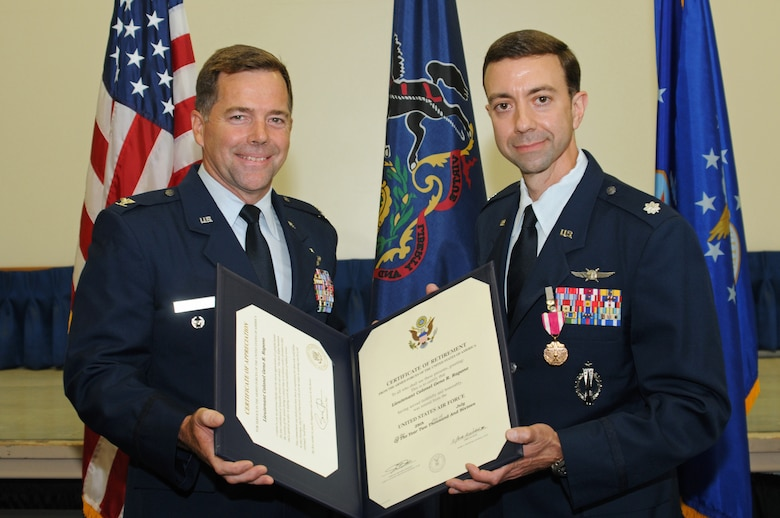 Lt. Col. Geno Rapone, Commander of the 270th Engineering and Installation Squadron, receives a certificate of appreciation presented to him by Col. William Griffin, Vice Commander of the 111th Attack Wing, during his retirement ceremony at Horsham Air Guard Station, Pa. on August 13, 2016. Rapone retires from uniformed military service with 20-plus years of exemplary and dedicated service. (U.S. Air National Guard photo by Staff Sgt. Michael Shaffer)