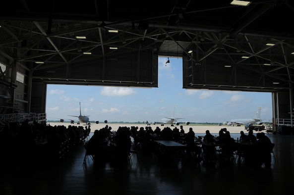 Officers from the 185th Air Refueling Wing Maintenance Group treat enlisted members to a burger burn lunch in the main hanger during home station annual training, in appreciation for their hard work at the Iowa Air National Guard in Sioux City, Iowa on August 17, 2016.  U.S. Air National Guard Photo by Master Sgt. Vincent De Groot/Released
