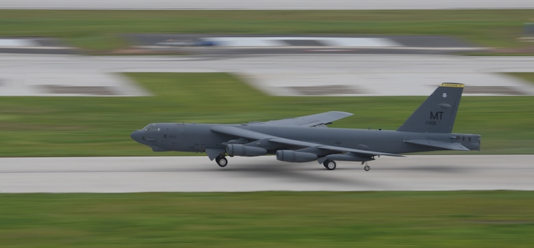 A U.S. Air Force B-52 Stratofortress takes off from Andersen Air Force Base, Guam, for an integrated bomber operation Aug.17, 2016. This mission marks the first time in history that all three of Air Force Global Strike Command's strategic bomber aircraft are simultaneously conducting integrated operations in the U.S. Pacific Command area of operations. As of Aug. 15, the B-1 Lancer will be temporarily deployed to Guam in support of U.S. Pacific Command's Continuous Bomber Presence mission. (U.S. Air Force photo by Airman 1st Class Jacob Skovo/Released)