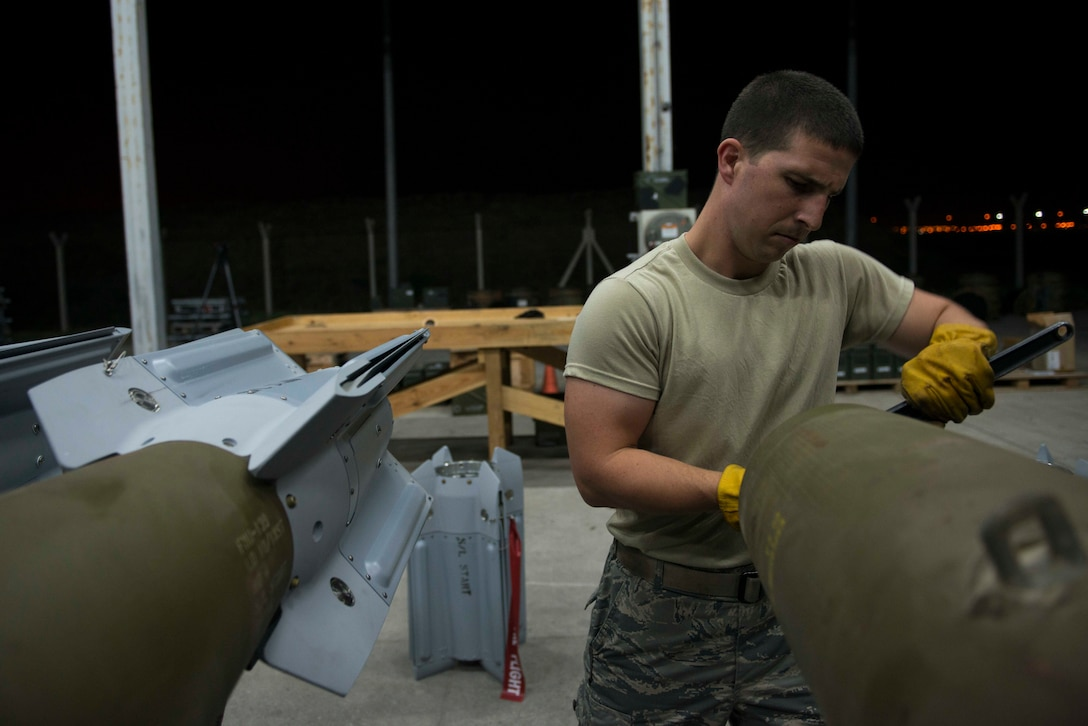 U.S. Air Force Staff Sgt. Curtis Downer, 447th Expeditionary Aircraft Maintenance Squadron munitions systems specialist, cleans thread wells on a GBU-12 Paveway II laser-guided bomb Aug. 8, 2016, at Incirlik Air Base, Turkey. Thread wells are cleaned prior to installing the fin to ensure a safe and secure attachment. (U.S. Air Force photo by Senior Airman John Nieves Camacho)