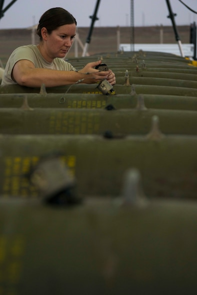 U.S. Air Force Master Sgt. Patricia Winn, 447th Expeditionary Aircraft Maintenance Squadron munitions systems specialist, installs a part onto a GBU-12 Paveway II laser-guided bomb Aug. 8, 2016, at Incirlik Air Base, Turkey. Munitions systems specialists receive, identify and store guided and unguided non-nuclear munitions. (U.S. Air Force photo by Senior Airman John Nieves Camacho)