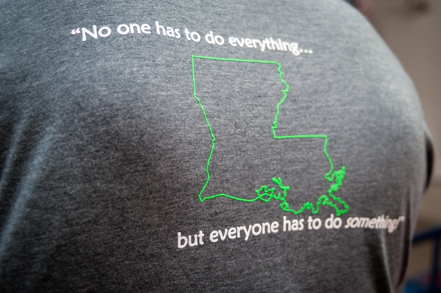 """A shirt displays the Green Dot motto """"no one has to do everything, but everyone has to do something"""" at Barksdale Air Force Base, La., Aug. 9, 2016. Recently, the Air Force contracted the non-profit Green Dot organization to take steps toward decreasing interpersonal violence, helping Airmen paint a canvas that does not accept blemishes of violence within the Air Force. (U.S. Air Force photo/Senior Airman Mozer O. Da Cunha)"""