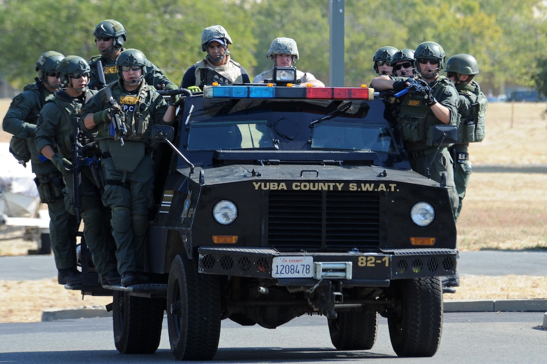Yuba County Sheriff's Department SWAT and Beale first responders drive on scene to an active shooter exercise Aug. 17, 2016, at Beale Air Force Base, California. Beale personnel and Yuba County SWAT worked cohesively to extract individuals on lockdown and eliminate the simulated threat. (U.S. Air Force photo by Senior Airman Ramon A. Adelan)