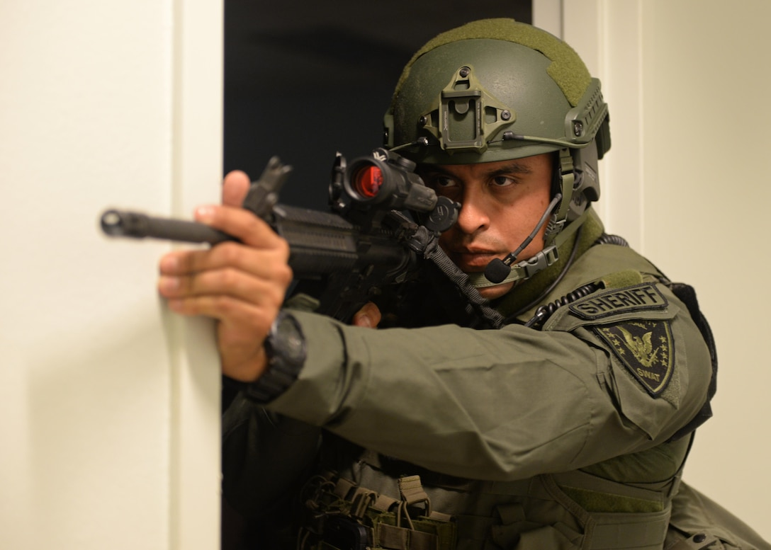 Deputy Sixto Torres, Yuba County Sheriff's Department SWAT, stands guard during an active shooter exercise Aug. 17, 2016, at Beale Air Force Base, California. Beale personnel and Yuba County SWAT worked cohesively to extract individuals on lockdown and eliminate the simulated threat. (U.S. Air Force photo by Senior Airman Ramon A. Adelan)