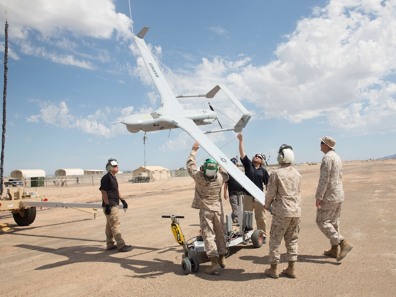 Marines with Marine Unmanned Aerial Vehicle Squadron (VMU) 1 recover their new RQ-21A Blackjack Unmanned Aerial System after its flight aboard Cannon Air Defense Complex in Yuma, Ariz., Aug. 16. VMU-1 received their new Blackjack's in June and conducted training to increase their proficiency with the new aircraft before they deploy with the 15th Marine Expeditionary Unit next year. The new aircraft is runway independent and leaves a significantly smaller footprint than their previous UAS. (U.S. Marine Corps photo by Sgt. Brytani Wheeler)