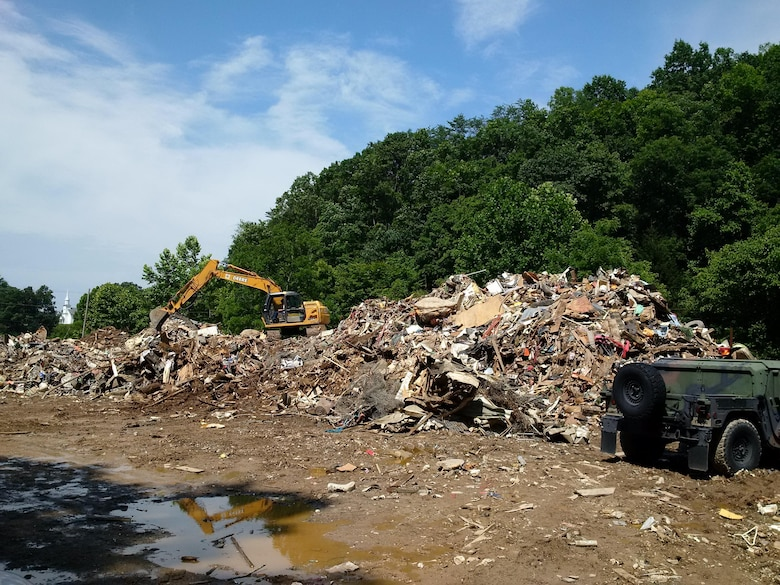 A temporary debris storage and reduction site in Clay County, West Virginia, where USACE representatives assisted with cleanup after the area experienced devastating floods.