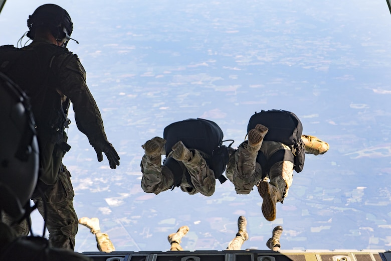 Pararescuemen jump from an HC-130J Combat King II at 25,000 feet, Aug. 18, 2016, in the skies over Moody Air Force Base, Ga. Pararescuemen are qualified experts in Airbourne and Military Free Fall operations, to include high-altitude, low opening techniques. (U.S. Air Force photo by Staff Sgt. Ryan Callaghan)