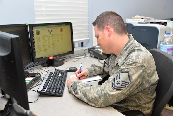 U.S. Air Force Master Sgt. Peter Griffin, Air Force Rescue Coordination Center superintendent, answers  the phone on the AFRCC Operations Floor at Tyndall Air Force Base, Fla., Aug. 18, 2016. Griffin worked the AFRCC mission marking the 200th save for the unit in 2016 on Aug. 17, 2016. The AFRCC operates 24 hours a day, seven days a week, and serves as the single agency responsible for coordinating on-land federal search and rescue activities in the 48 contiguous United States, Mexico, and Canada. (Photo by Maj. Andrew Scott)