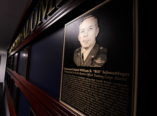 An engraved photo of retired Lt. Col. William Schwertfeger, 2016 Holm Center Distinguished Alumni inductee, hangs on display besides the previous honorees on the Distinguished Alumni wall inside the Air Force Reserve Officer Training Corps Headquarters, August 18, 2006, Maxwell Air Force Base, Ala. The Distinguished Alumni program honors graduates who achieved a high level of success during or after their service in the Air Force. (U.S. Air Force photo/ SrA Alexa Culbert)