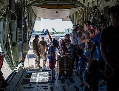 "A crowd gathers to walk through a U.S. Marine Corps KC-130J Hercules assigned to Marine Aerial Refueler Transport Squadron (VMGR) 152 during Exercise Pitch Black 2016 Open Day at Royal Australian Air Force Base Darwin, Australia, Aug. 13, 2016. For over 70 years, VMGR-152, also known as the ""Sumos,"" has successfully carried out support missions by providing aerial refueling and assault support during expeditionary, joint and combined operations like Exercise Pitch Black 2016. The biennial, multinational exercise involves approximately 10 allied nations and prepares these forces for possible real-world scenarios. The bilateral effort amongst Exercise Pitch Black 2016 furthermore showcases the strength amongst various militaries and solidifies the relationship across the Pacific region. (U.S. Marine Corps photo by Cpl. Nicole Zurbrugg)"