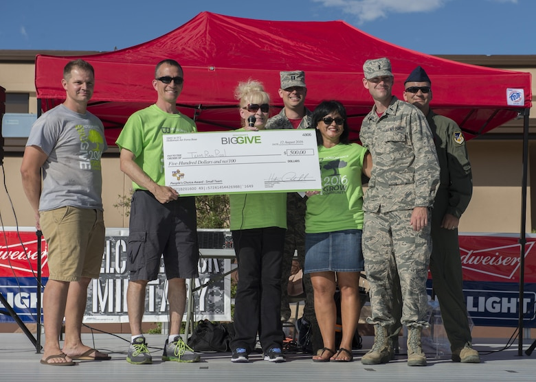 Members from the 49th Operation Support Squadron's Team Ram Rod! receive their $500 reward for winning the People's Choice Small Team Award during the Big Give after-party August 12, 2016 at Holloman Air Force Base, N.M. Over the course of three weeks, 32 teams of 412 participants spent nearly 5,000 man hours volunteering in the local community — saving the area $202,092.33. (Last names are being withheld due to operational requirements. U.S. Air Force photo by Airman 1st Class Randahl J. Jenson)