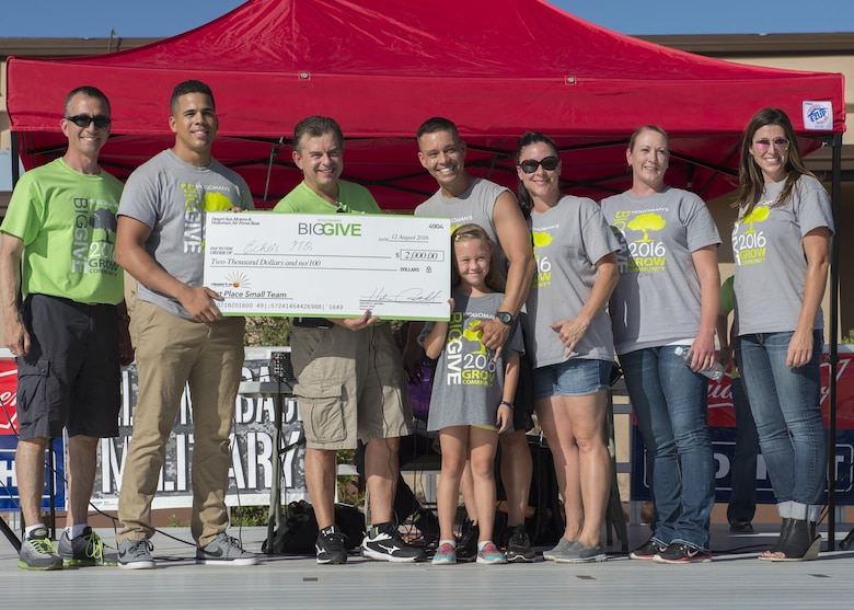 Members from the 49th Mission Support Group's Echo's PTO receive their $2,000 reward for winning the Small Team Award at the Big Give after-party August 12, 2016 at Holloman Air Force Base, N.M. Over the course of three weeks, 32 teams of 412 participants spent nearly 5,000 man hours volunteering in the local community — saving the area $202,092.33. (U.S. Air Force photo by Airman 1st Class Randahl J. Jenson)