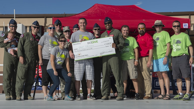 Members from the 29th Attack Squadron's team, Ghost Warriors, receive their $5,000 reward for winning the First Place Large Team Award at the Big Give after-party August 12, 2016 at Holloman Air Force Base, N.M. Over the course of three weeks, 32 teams of 412 participants spent nearly 5,000 man hours volunteering in the local community — saving the area $202,092.33. (Last names are being withheld due to operational requirements. U.S. Air Force photo by Airman 1st Class Randahl J. Jenson)