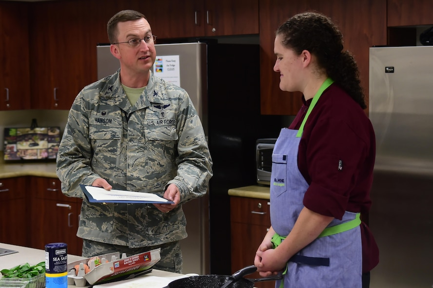 Col. Matthew Hanson, 460th Medical Group commander, presents Charlotte Muller, Whole Foods chef, a certificate of appreciation August 18, 2016, at the Health and Wellness Center on Buckley Air Force Base, Colo. Muller visits Buckley every month to put on a cooking demonstration for people looking to improve the quality and health of their own cooking. (U.S. Air Force photo by Senior Airman Luke W. Nowakowski/Released)