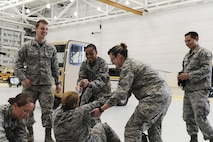 U.S. Airmen assigned to the 354th Medical Operations Squadron at Eielson Air Force, Alaska, participate in joint training Aug. 12, 2016, in Hangar 6 at Ladd Army Airfield on Fort Wainwright, Alaska. Members of the 354th Medical Group trained in preparation for the upcoming Emergency Medical Technician (EMT) Rodeo, a competition where EMT teams demonstrate their lifesaving skills under austere conditions. (U.S. Air Force photo by Airman Isaac Johnson)