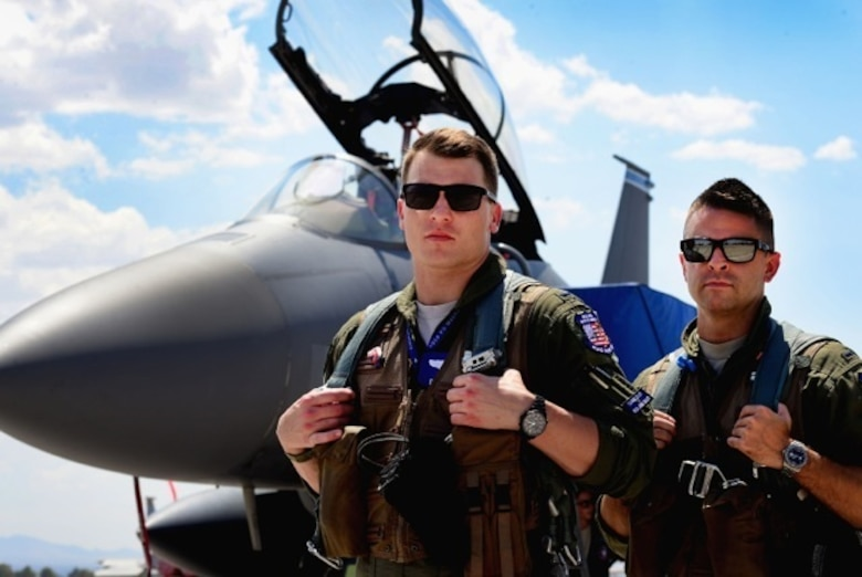 U.S. Air Force 1st Lieutenant Drew Lyons, 492nd Fighter Squadron, F-15E Strike Eagle pilot, and 1st Lieutenant J. Paul Reasner, 492nd FS, F-15E Strike Eagle weapon systems officer, gear up for a sortie in support of exercise Red Flag 16-4 at Nellis Air Force Base, Nevada Aug 17. Lyons and Reasner's goal as first-time participants at Red Flag is to benefit from each training scenario and become better wingmen for their squadron. (U.S. Air Force photo/ Tech. Sgt. Matthew Plew)