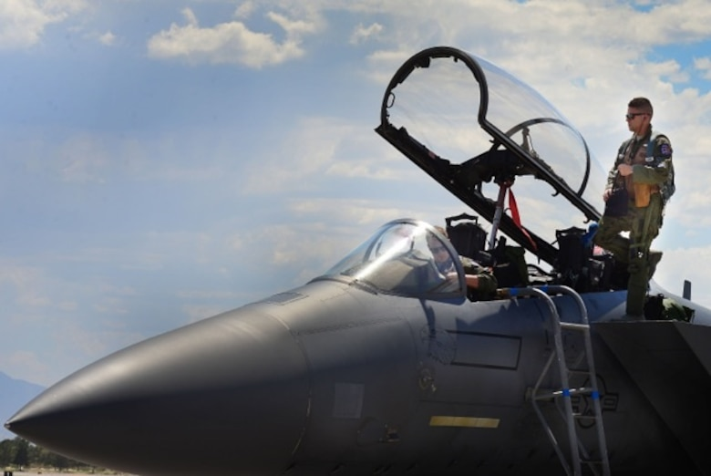 U.S. Air Force 1st Lieutenant Drew Lyons, 492nd Fighter Squadron, F-15E Strike Eagle pilot, and 1st Lieutenant J. Paul Reasner, 492nd FS, F-15E Strike Eagle weapon systems officer, make final observations of their aircraft prior to a sortie in support of exercise Red Flag 16-4 at Nellis Air Force Base, Nevada Aug 17. Red Flag is the U.S. Air Force's premier air-to-air combat training exercise and one of a series of advanced training programs that is administered by the U.S. Air Force Warfare Center and executed through the 414th Combat Training Squadron. (U.S. Air Force photo/ Tech. Sgt. Matthew Plew)