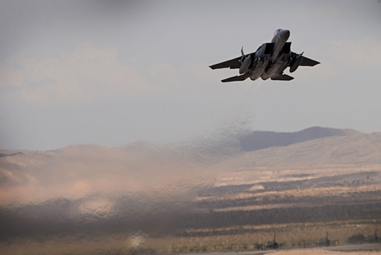 U.S. Air Force 1st Lieutenant Drew Lyons, 492nd Fighter Squadron, F-15E Strike Eagle pilot, and 1st Lieutenant J. Paul Reasner, 492nd FS, F-15E Strike Eagle weapon systems officer, launch for a sortie in support of exercise Red Flag 16-4 at Nellis Air Force Base, Nevada Aug 17. Red Flag is the U.S. Air Force's premier air-to-air combat training exercise and one of a series of advanced training programs that is administered by the U.S. Air Force Warfare Center and executed through the 414th Combat Training Squadron. (U.S. Air Force photo/ Tech. Sgt. Matthew Plew)