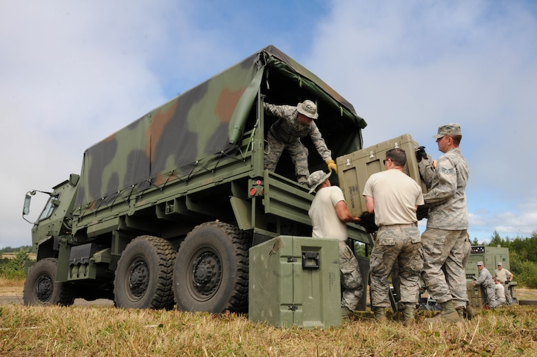 Oregon Air National Guard members, 270th Air Traffic Control Squadron, load a M1083 five-ton cargo truck during the ATCS annual training at Newport, Ore., Aug. 10, 2016. Members convoyed nearly 300 miles from Klamath Falls, Ore., where they set up their MSN-7 mobile tower, TRN-48 Tactical Air Navigation (TACAN) system, and all supporting equipment which allows them to guide aircraft into and out of nearly any airfield in the world. (U.S. Air National Guard photo by Staff Sgt. Penny Snoozy)