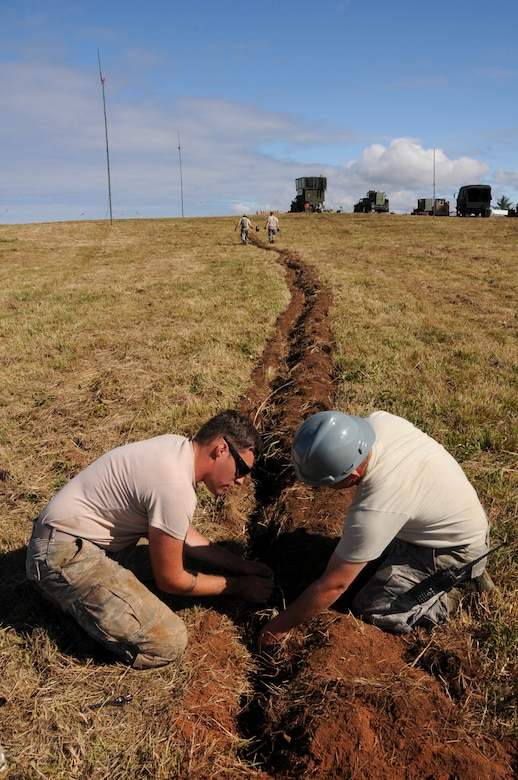 Oregon Air National Guard members, 270th Air Traffic Control Squadron, lay down copper wire for the grounding system during the ATCS annual training at Newport, Ore., Aug. 10, 2016. Members convoyed nearly 300 miles from Klamath Falls, Ore., where they set up their MSN-7 mobile tower, TRN-48 Tactical Air Navigation (TACAN) system, and all supporting equipment which allows them to guide aircraft into and out of nearly any airfield in the world. (U.S. Air National Guard photo by Staff Sgt. Penny Snoozy)