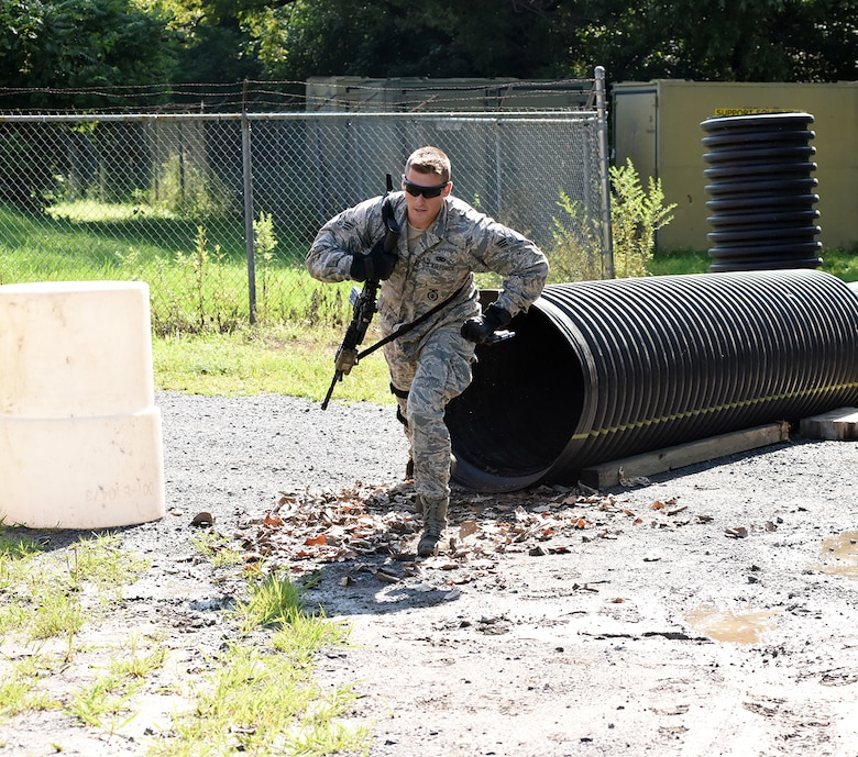 Senior Airman Brendan Leach, 109th Security Forces Squadron, goes through a combat combative obstacle course on Aug. 11, 2016 at Stratton Air National Guard Base, New York. The course was part of a weeklong pre-deployment training Warrior Week for Security Forces Airmen here. (U.S. Air National Guard photo by Master Sgt. William Gizara/Released)