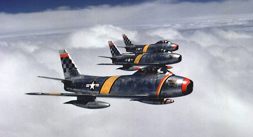 A three-ship formation of F-86F Sabres assigned to the 51st Fighter-Interceptor Wing fly over Korea in 1953. The 51st Fighter Wing, under various designations, fought in the Korean War and has provided aerial support and deterrence on the Korean Peninsula since 1971. (Courtesy photo)