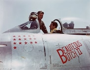 Capt. Joseph McConnell, center, sits in the cockpit of his F-86 Sabre before a combat sortie during the Korean War. McConnell was the war's top American ace, scoring 16 confirmed kills, and the Air Force's first triple jet-on-jet ace. (Courtesy photo)
