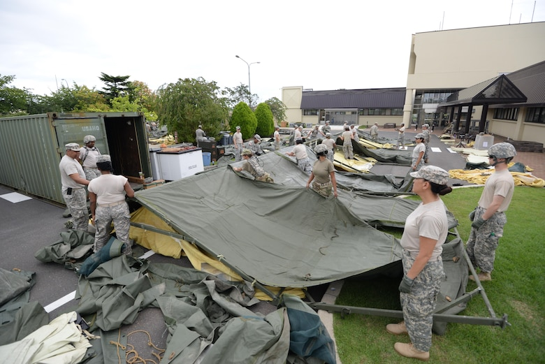 U.S. Army Soldiers from the 228th Combat Support Hospital, U.S. Army Reserve unit construct tents in support of a medical exercise at Misawa Air Base, Japan, Aug. 18, 2016. The 228th CSH will be conducting joint exercises with the 35th Medical Group over the course of a week. (U.S. Air Force photo by Senior Airman Jarrod Vickers)