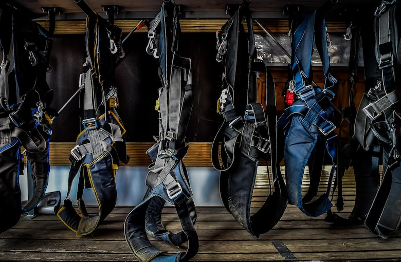 Skydiving harnesses hang on a rack in Wallerfangen, Germany, Aug. 13, 2016. The 86th Airlift Wing Chapel and Club 7 gave 15 Airmen from Ramstein Air Base, Germany, the opportunity to take a 'leap of faith' during a skydiving trip to build upon the pillars of RUfit. (U.S. Air Force photo/Senior Airman Nicole Keim)