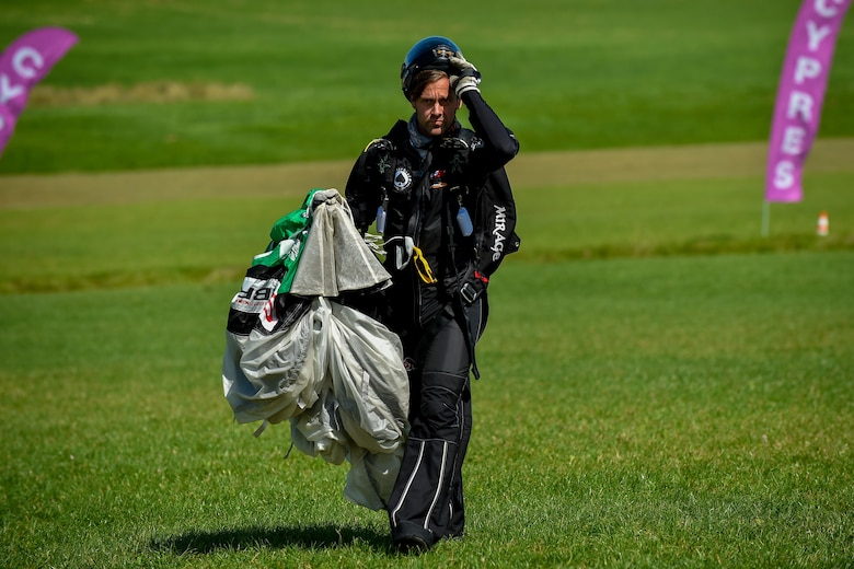 A skydiver walks with his parachute after landing a jump in Wallerfangen, Germany, Aug. 13, 2016. The jumper had an average of five skydiving jumps per day. (U.S. Air Force photo/Senior Airman Nicole Keim)