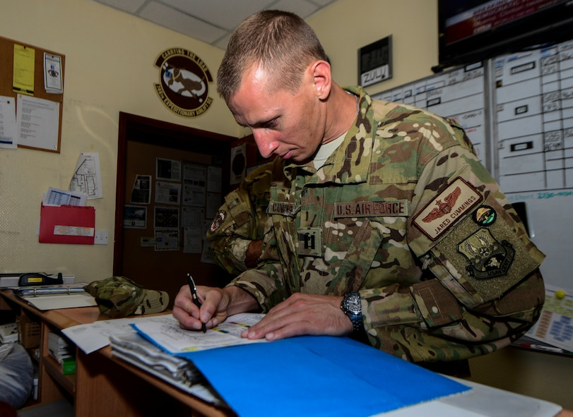 Capt. Jared Cummings, 746th Expeditionary Airlift Squadron aircraft commander, reviews the crew resource management paperwork prior to conducting a mission on a C-130H Hercules July 28, 2016, at Al Udeid Air Base, Qatar. Airmen from the 746th EAS conduct intratheater airlifts, medical evacuation and airdrop missions throughout the U.S. Air Forces Central Command's area of responsibility in support of Operation Inherent Resolve and Operations Freedom's Sentinel. (U.S. Air Force photo/Senior Airman Janelle Patiño/Released)