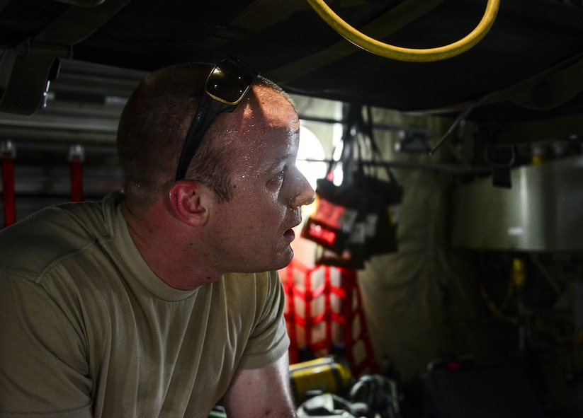 Staff Sgt. Andrew Harkcom, 379th Expeditionary Aeromedical Evacuation Squadron aeromedical evacuation technician, talks with team members while setting up a C-130 Hercules prior to cargo and passengers arriving July 28, 2016, at Al Udeid Air Base, Qatar. The equipment package for an aeromedical evacuation mission contains roughly about 1,200 to 1,400 pounds of equipment on each mission. (U.S. Air Force photo/Senior Airman Janelle Patiño/Released)