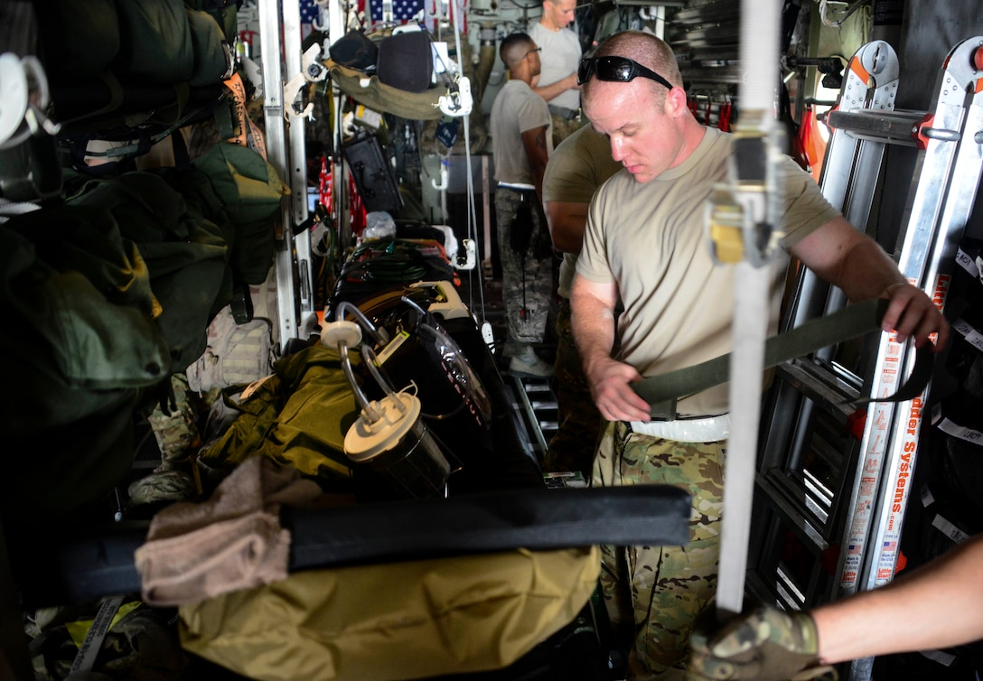 Staff Sgt. Andrew Harkcom, 379th Expeditionary Aeromedical Evacuation Squadron aeromedical evacuation technician, secures medical equipment to the litter prior to take off June 28, 2016, at Al Udeid Air Base, Qatar. The equipment package for an aeromedical evacuation mission contains roughly about 1,200 to 1,400 pounds of equipment on each mission. The aeromedical evacuation team ensures every piece of equipment is secured prior to take off to prevent items from moving during the flight. (U.S. Air Force photo/Senior Airman Janelle Patiño/Released)