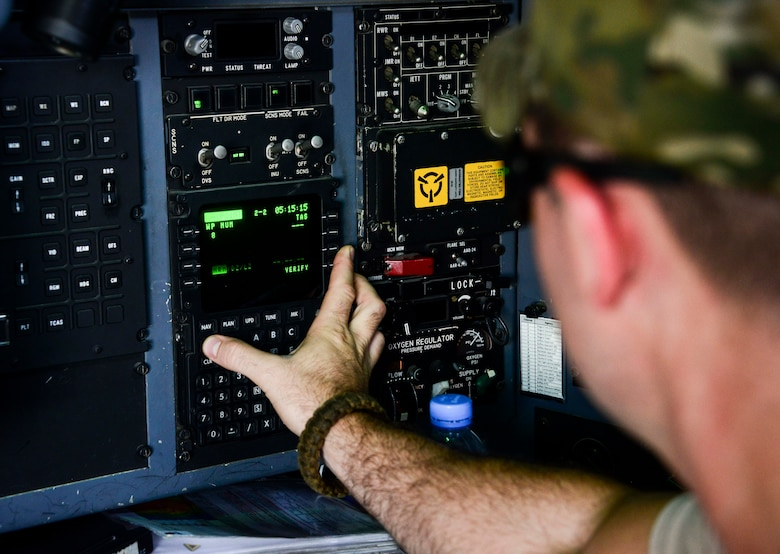 Capt. Steve Bichsel, 746th Expeditionary Airlift Squadron navigator, loads the navigation system of a C-130 Hercules prior to take off June 28, 2016, at Al Udeid Air Base, Qatar. Bichsel is deployed from the 914th Airlift Wing out of Niagara Falls Air Reserve Station, N.Y. This year marks the last time the 914th AW Airmen and four of its C-130's last deploy here as they transition to KC-135 Stratotankers. (U.S. Air Force photo/Senior Airman Janelle Patiño/Released)